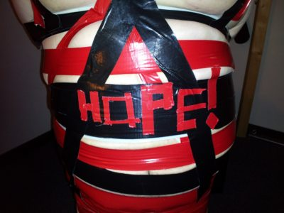 Detail on Hope's adding her name in duct tape