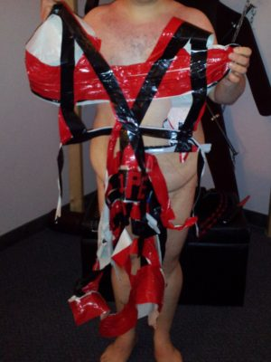 Holding up the remains of the duct tape dress