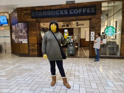 "Standing in front of Starbucks at Tysons Corner Mall, holding up a cup of coffee.  My girlfriend described this photo as my having achieved ""basic bitch"" status."