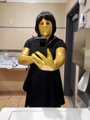 Taking a selfie in my little black dress in the restroom at a Walmart store. I used to work at this particular location a long time ago, and so it felt a little bit weird going in there in drag. While there, I decided to see how complete my cover was. So I went through the checkout line of a former coworker, and who I'm also friends with on Facebook. I checked out, we talked, and I paid with the Jennifer card. And wouldn't you know it - my former colleague didn't recognize me.