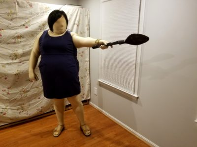 Jennifer poses with the spoon in the dungeon room
